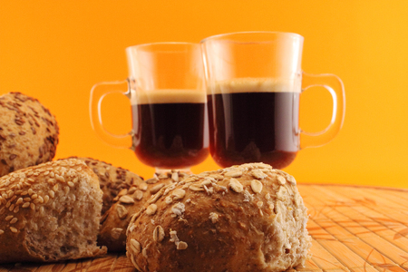 Conceptual image about nutrition and lifestyle and food. Baked bread and hot coffee.