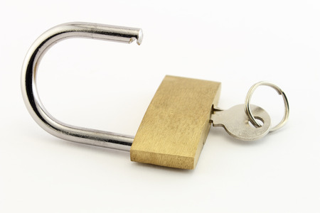 An open padlock with key. Conceptual image isolated on white.
