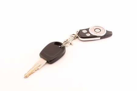 Car key white backround. Close-up car remote control. photo