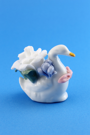 White swan with flowers made of ceramic. Crafts to decorate the house. Stock Photo - 28832321