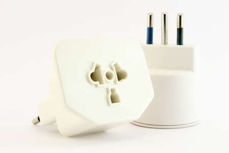 unplugged: Closeup of a plug and socket unplugged isolated on a white background.  Stock Photo