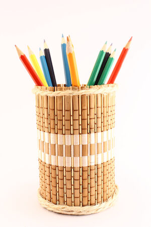 Colored pencils on a wooden pencil-holders photo