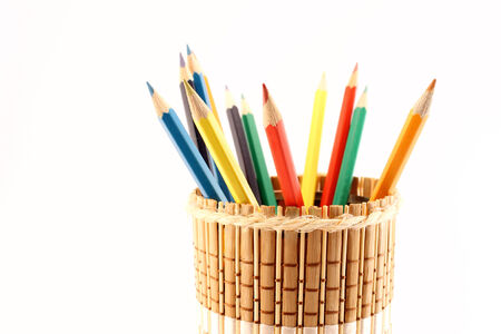Close-up of a colored pencils on a wooden pencil-holders photo