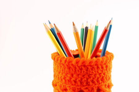 Close-up of acColored pencils in a pencil holder fleece-lined orange photo