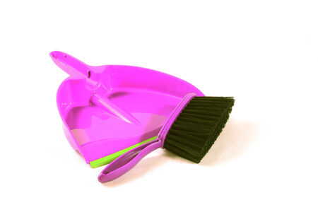 Brush and dustpan to pick up trash at home. Tools isolated on white background.