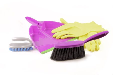 office cleanup: Brush, gloves and dustpan isolated on white background.