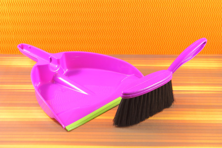 office cleanup: Violet brush and dustpan to clean the home.