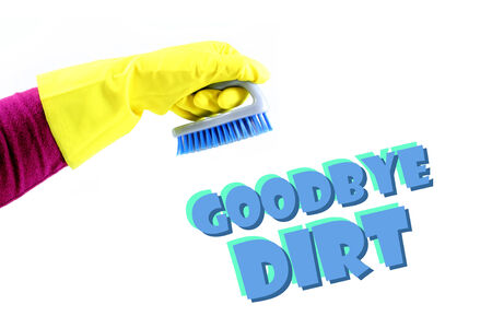 Conceptual image about the cleaning at home. Hand holding a brush.