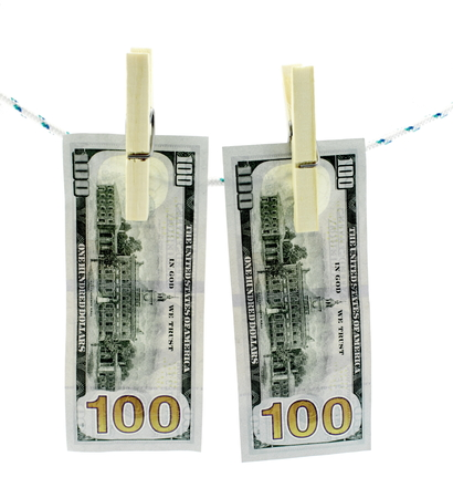 Concept laundering dirty money. Banknotes hanging on a rope to dry clothes. photo