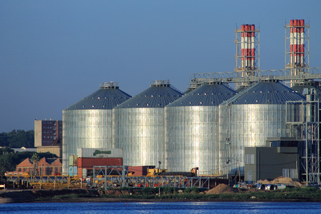 grain storage: Four large silos for grain storage located on the bay, near the port of Montevideo, Uruguay. Editorial