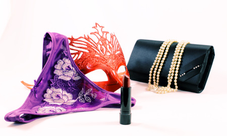 undies: Sexy lingerie, a red mask, a lipstick, necklace and a bag of woman isolated on white background. Womens fashion accessories.