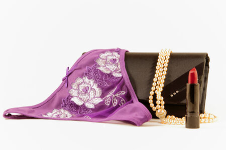 undies: Female accessories. Necklace, wallet, lipstick and sexy panties. Stock Photo