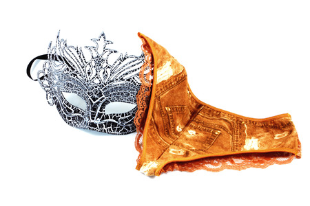 knickers: A black mask and red orange panty isolated on white background. Stock Photo