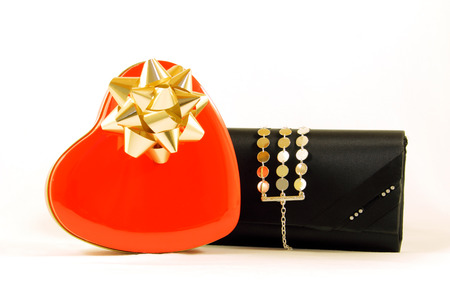 box of chocolates: Metal box chocolates, red heart-shaped and stylish black wallet women, isolated on white.