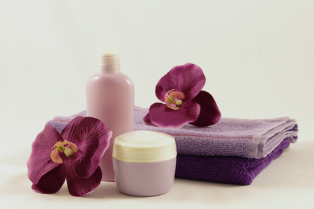 Female beauty accessories and cosmetics. Towels and jars of creams.