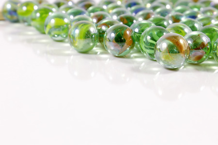 Glossy marbles on white background photo