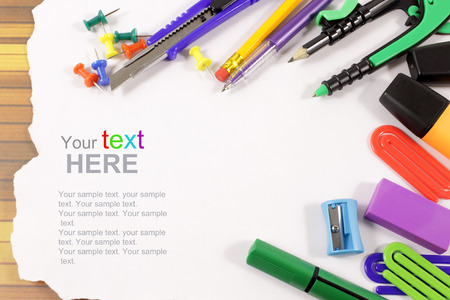 Back to school concept. School stationery isolated over white with copyspace. photo