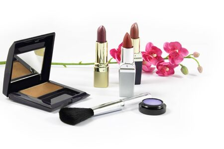 Women cosmetics and lipsticks. Isolated. photo
