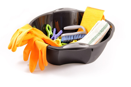 clothespeg: Black wash bowl with colorful clothes-peg, orange gloves and brush, isolated on white