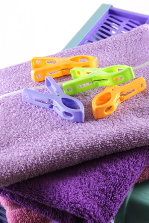 clothespeg: Clothing crate Laundry, towels and clothes-peg Stock Photo