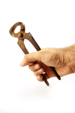 Hand with Vintage pincers on white background photo