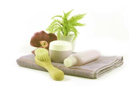 Towel and feminine products, pot with cream and brush photo