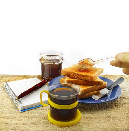 smearing: Hand smearing jam on toast