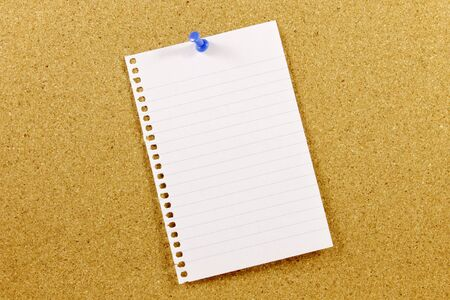 cork sheet: Sheet of paper to write a message. Pinned on a cork bulletin board. Stock Photo