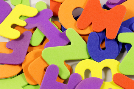 verbs: Scrambled letters together in a colorful background.