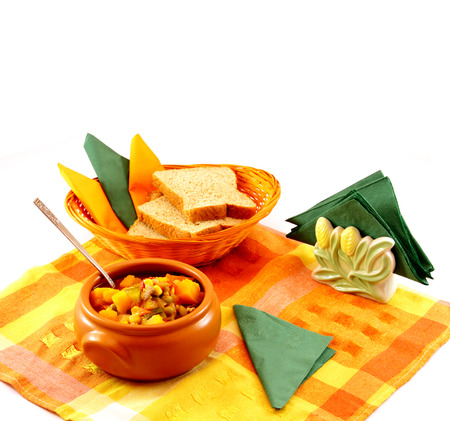 pileup: Delicious hot food. Stew of meat and vegetables in a Clay bowl with sliced bread. Stock Photo