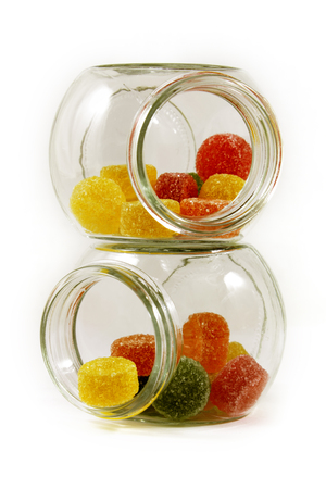 sparce: Sweet sugar candies in glass jars, isolated on white. Stock Photo