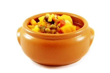 pileup: Delicious hot food. Stew of meat and vegetables in a Clay bowl