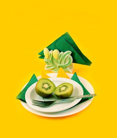 kiwis: Two kiwis on a white plate, a side view Stock Photo