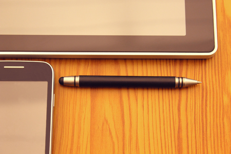communication tools: Tablet, stylus and mobile. Modern Digital devices Indispensable Communication Tools.