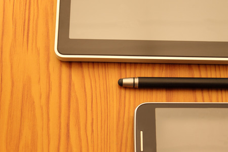 communication tools: stylus, tablet and mobile, Modern Digital devices Indispensable Communication Tools. Stock Photo