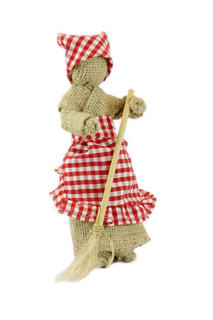 coif: Woman with a broom in her hands. Burlap doll with cap and apron.