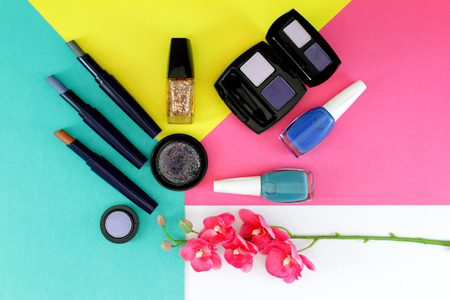 Flat lay composition with make-up cosmetics over white bacground
