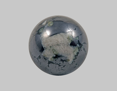A magnetite stone, round on an isolated background.