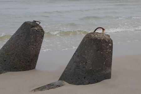 Baltic Sea coastline with concrete concrete breakwaters Reklamní fotografie