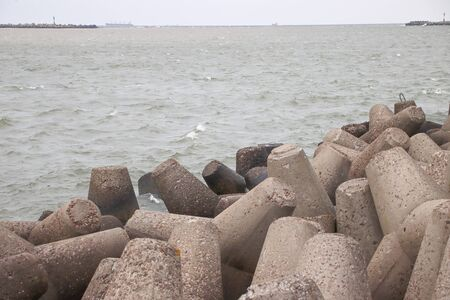 Tetrapods along the waterfront sea wall, port breakwater concrete Reklamní fotografie