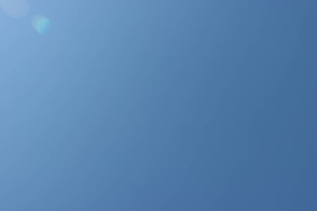 Blue, cloudless sky. Background of the transparent atmosphere of the earth. Reklamní fotografie