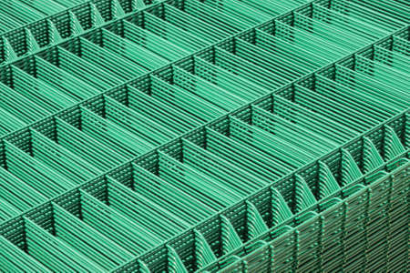 Production of metal mesh for land fencing.