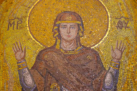 Holy Mary. Unbreakable wall mosaic in a Christian church.