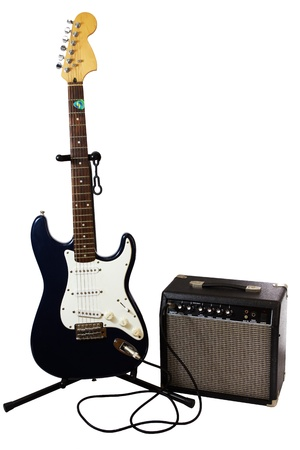 Electric guitar and amplifier isolated on white. Imagens
