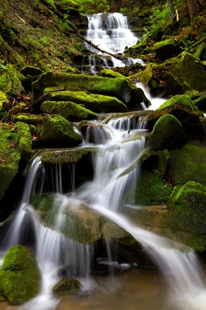 Cascading waterfall during spring located in Oil Creek State Park