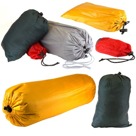 Bags of camping equipment isolated on a white background