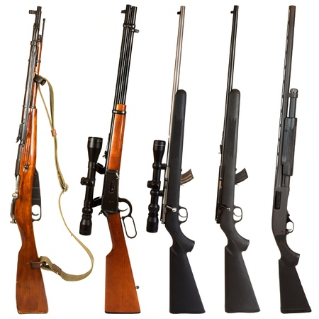 Rifles isolated on white background depicting a Russian bolt action Mosin Nagant, 30-30 Winchester lever action rifle, 22. bolt action rifle with scope, 22. bolt action rifle without a scope, and a black pump-action 12 gauge shotgun. photo