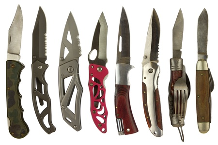 Knife collage isolated on a white background depicting a variety of pocket knives.