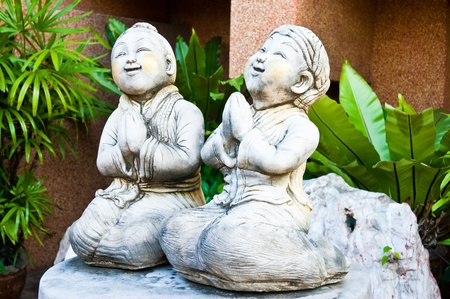 thai statues smiling faces are getting respect in thailand photo