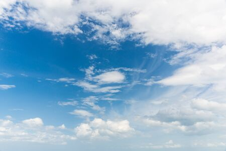 seson: a cloud and bright sky during the daytime
